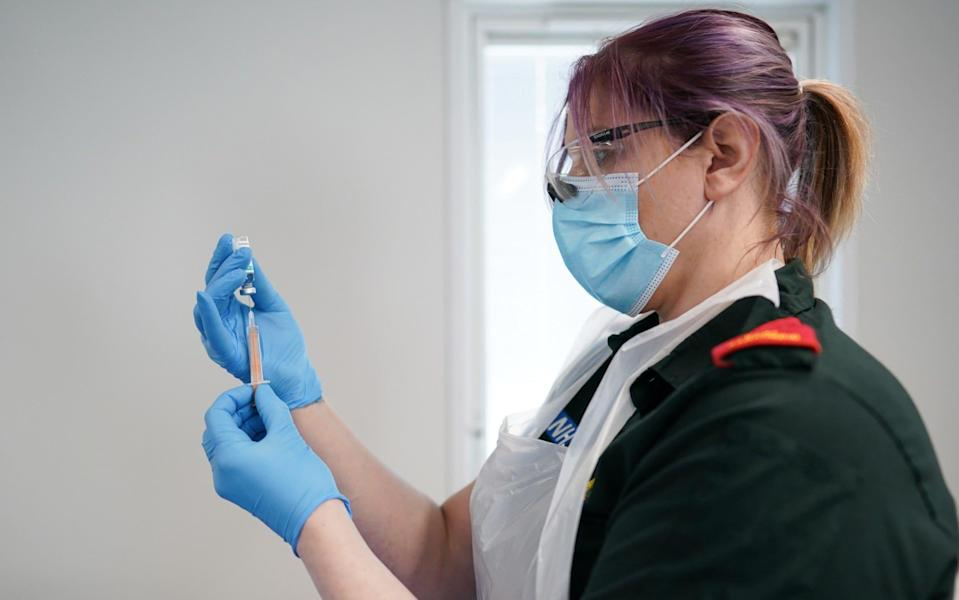 Angela Arnot, a paramedic with the Hazardous Area Response Team draws up the AstraZeneca/Oxford University Covid-19 vaccine at the Darlington Arena Vaccination Centre - Getty