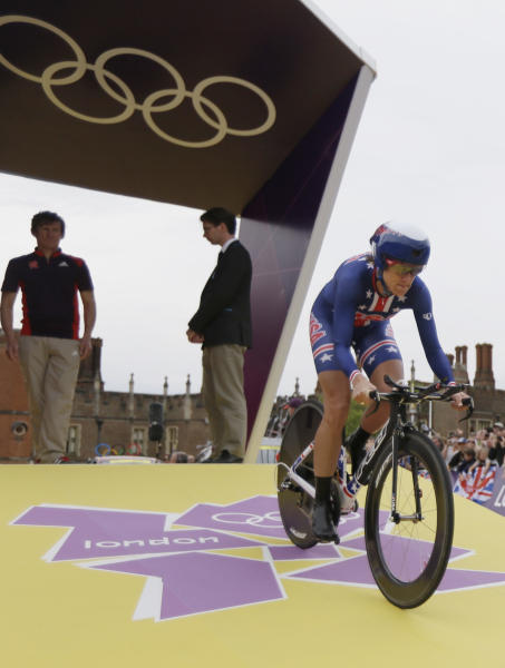 Gold medalist Kristin Armstrong, of the United States, competes in the women's individual time trial cycling event at the 2012 Summer Olympics, Wednesday, Aug. 1, 2012, in London. (AP Photo/Matt Rourke)