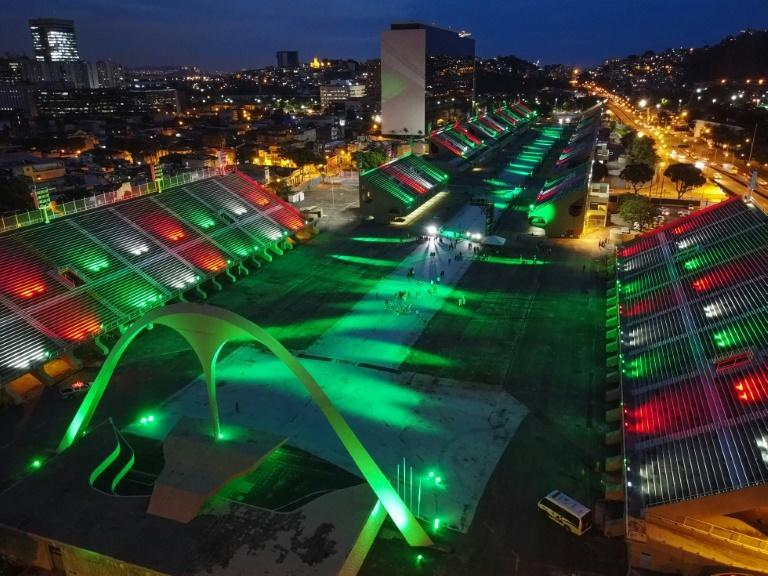 Colorful lights are seen in February 2020 illuminating Rio's Sambadrome, the stadium where the city's top samba schools would normally hold their annual carnival competition; this year the stands are empty as Covid forced cancellation of the event