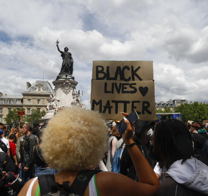 Thousands of people take part in a march against police brutality and racism in Paris, France, Saturday, June 13, 2020, organized by supporters of Adama Traore, who died in police custody in 2016 in circumstances that remain unclear despite four years of back-and-forth autopsies. The march is expected to be the biggest of several demonstrations Saturday inspired by the Black Lives Matter movement in the U.S., and French police ordered the closure of freshly reopened restaurants and shops along the route fearing possible violence. (AP Photo/Thibault Camus)