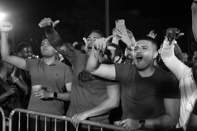 <p>The air grew thick with the smell of cigars, as the increasingly rowdy crowd continued to smoke and drink as the night went on at the Brooklyn Smoker on Aug. 24, 2017. (Photo: Gordon Donovan/Yahoo News) </p>