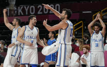 Italy players celebrate scoring by a teammate during men's basketball preliminary round game against Nigeria at the 2020 Summer Olympics, Saturday, July 31, 2021, in Saitama, Japan. (AP Photo/Eric Gay)