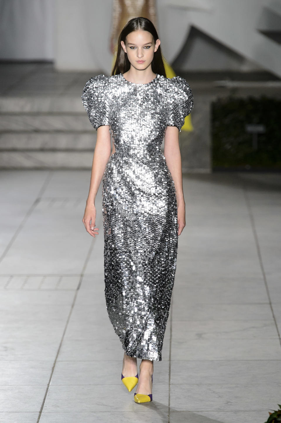 <p><i>Model wears a silver sequined dress with puffed sleeves from the SS18 Carolina Herrera collection. (Photo: IMAXtree) </i></p>