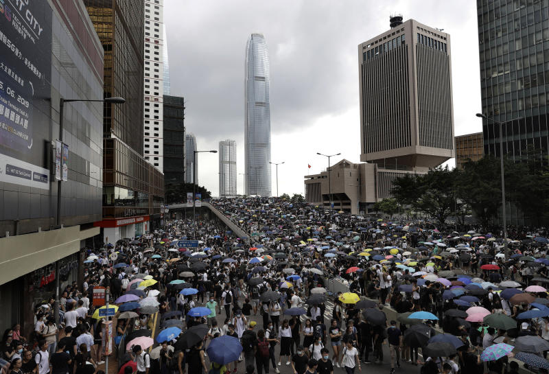 THousands of protesters gather outside the Legislative Council in Hong Kong, Wednesday, June 12, 2019. Hundreds of protesters have blocked access to Hong Kong's legislature and government headquarters in a bid to block debate on a highly controversial extradition bill that would allow accused people to be sent to China for trial. (AP Photo/Vincent Yu)