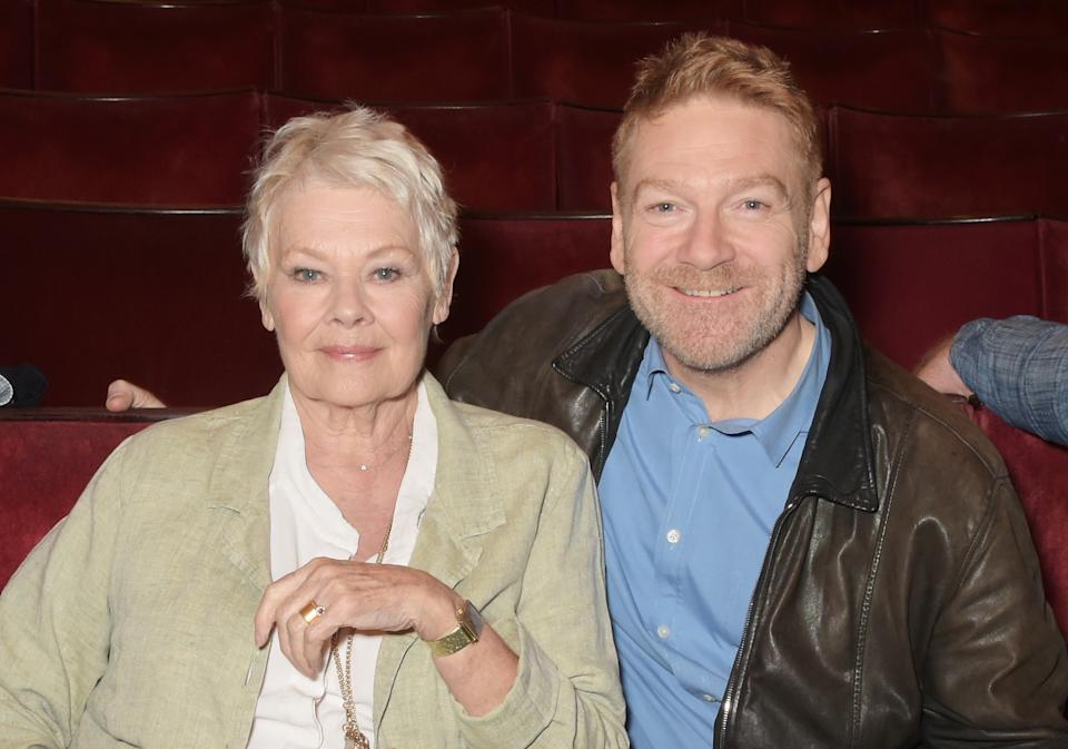 """LONDON, ENGLAND - APRIL 17: Dame Judi Dench (L) and Kenneth Branagh pose at a photocall to launch """"Plays At The Garrick"""", the inaugural season of plays from The Kenneth Branagh Theatre Company, at The Garrick Theatre on April 17, 2015 in London, England. (Photo by David M. Benett/Getty Images)"""