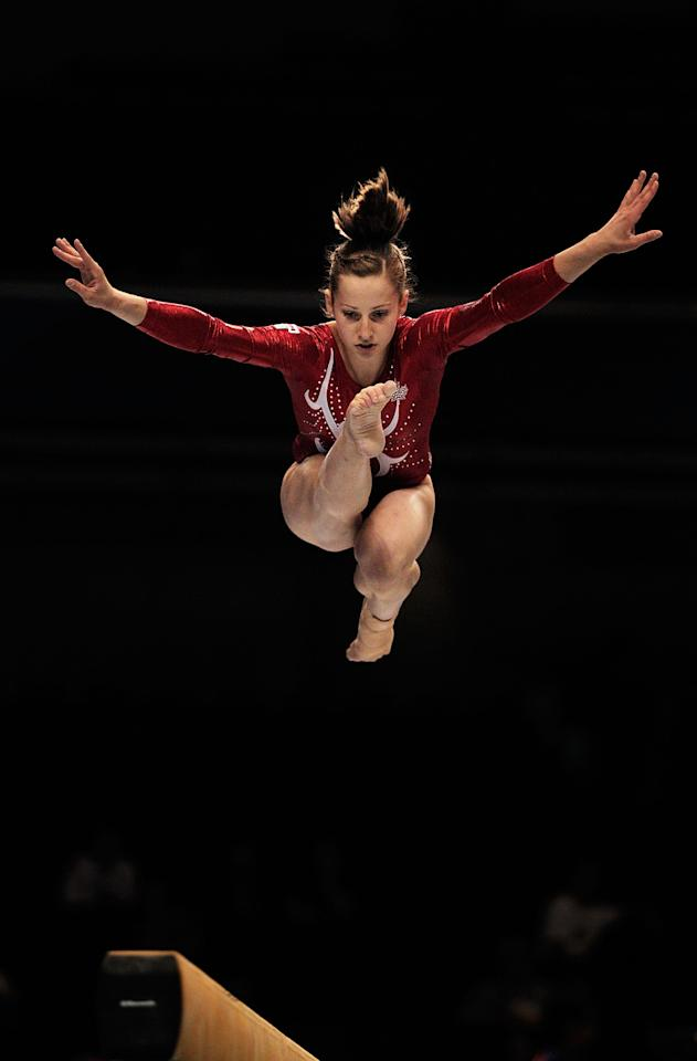 TOKYO, JAPAN - OCTOBER 07:  Dominique Pegg of Canada performs on the Beam aparatus in the Women's Qualification during the day one of the Artistic Gymnastics World Championships Tokyo 2011 at Tokyo Metropolitan Gymnasium on October 7, 2011 in Tokyo, Japan.  (Photo by Adam Pretty/Getty Images)