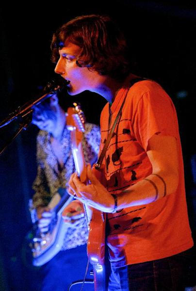 Bradford Cox, left, and Lockett Pundt sing and play guitar along with other members of the indie rock group Deerhunter, perform at One Eyed Jack's in the French Quarter in New Orleans, Monday, April 29, 2013. (AP Photo/Matthew Hinton)