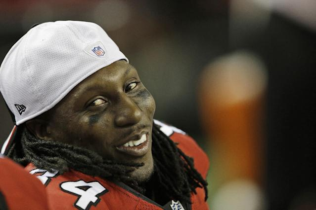 FILE - In this Aug. 8, 2013 file photo, Atlanta Falcons wide receiver Roddy White (84) smiles on the sideline during a preseason game against the Cincinnati Bengals in Atlanta. On the eve of training camp, the Falcons have agreed to terms on a new contract with receiver White. The Falcons announced the four-year extension Thursday, July 24, 2014. (AP Photo/John Bazemore, File)