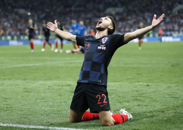 Croatia's Josip Pivaric celebrates after his team advanced to the final during the semifinal match between Croatia and England at the 2018 soccer World Cup in the Luzhniki Stadium in Moscow, Russia, Wednesday, July 11, 2018. (AP Photo/Frank Augstein)