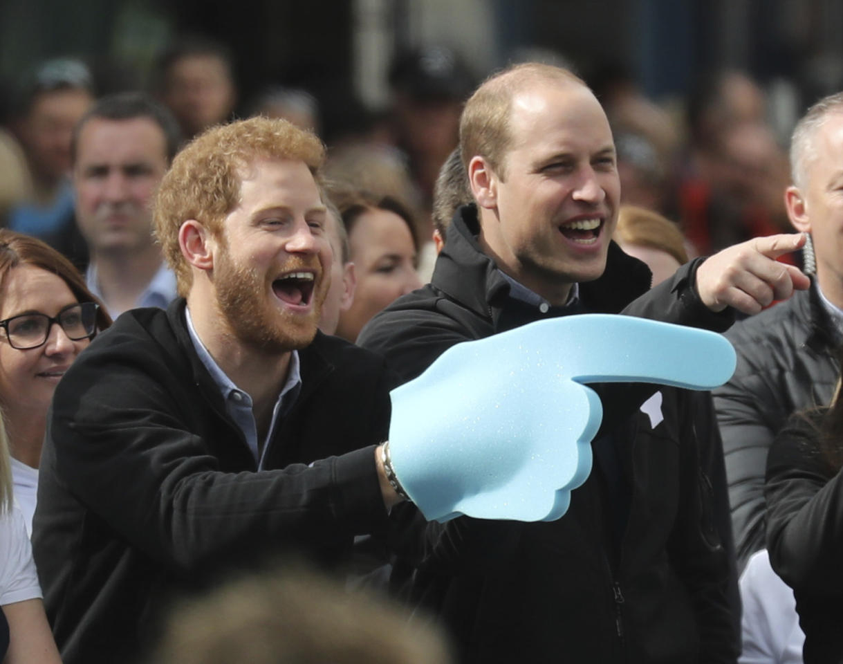 <p>Britain's Prince Harry, left, and his brother Prince William, the Duke of Cambridge, urge on runners at the Head Together cheering point during the London Marathon in Blackheath, London, Sunday April 23, 2017. (Chris Radburn/ PA via AP) </p>