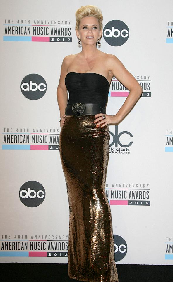 AMAs 2012: We're undecided about Heidi Klum's ensemble. We love the gold, and let's face it, Heidi's legs were made for that thigh-high split. However, we're not so keen on the boob flashing and the high neckline. Copyright [WENN]