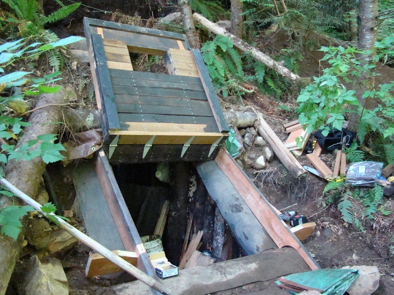 This undated photo provided by the King County Sheriff's Department on Friday, April 27, 2012, shows a bunker that deputies say belongs to a man suspected of killing his wife and daughter and holing up for days in the Cascade foothills east of Seattle. King County Sheriff's Sgt. Cindi West says authorities pumped gas into the underground bunker and they believe someone is inside. (AP Photo/King County Sheriff's Department)