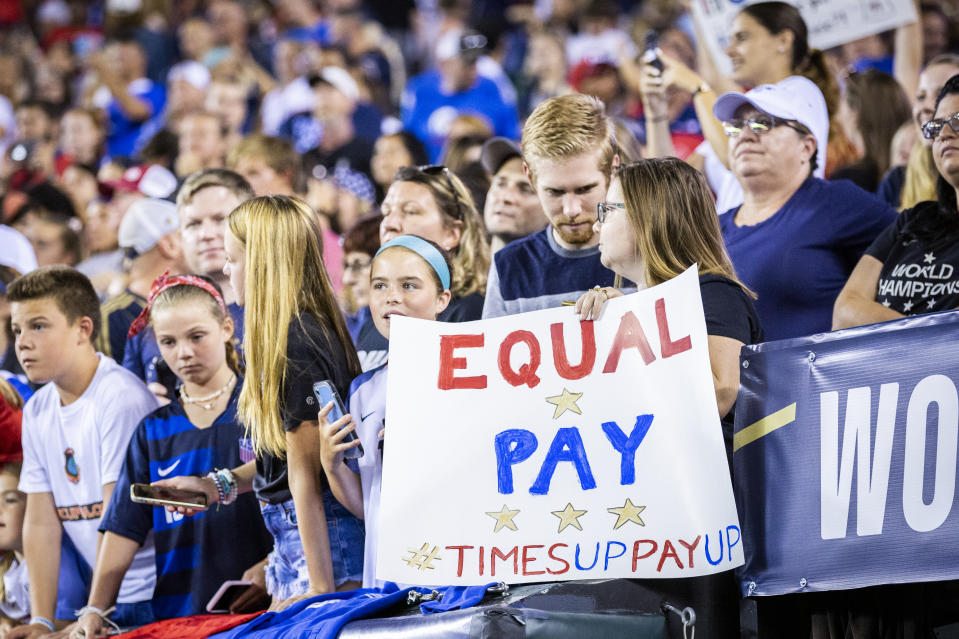 "HARRISON, NJ - MARCH 08: A fan holds up a sign that says ""Equal Pay Times Up Pay Up"" in support of the United States Women's National Team fight for equal pay. This was during the 2020 SheBelieves Cup match between United States and Spain sponsored by Visa.  The match took place at Red Bull Arena on March 08, 2020 in Harrison, NJ, USA.  The United States won by a score of 1 to 0. On May 1, 2020, a Federal Judge dismissed the equal pay claims of the World Cup Champions. (Photo by Ira L. Black/Corbis via Getty Images)"