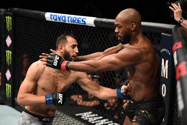(L-R) Dominick Reyes punches Jon Jones in their light heavyweight championship bout during UFC 247 at Toyota Center on Feb. 8, 2020 in Houston, Texas. (Josh Hedges/Zuffa LLC via Getty Images)