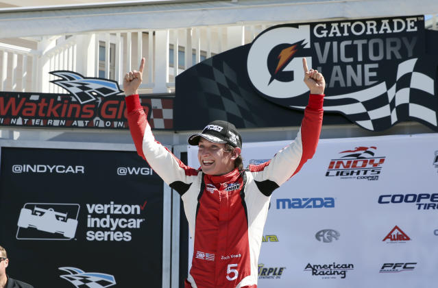 FILE - In this Sept. 3, 2016, file photo, Zach Veach (5) celebrates in Victory Lane after winning an Indy Lights auto race at The Glen in Watkins Glen, N.Y. Twenty-three-year-old Veach looks like the perfect guy for IndyCars youth movement. He has a solid resume. He has a full-time ride with one of the series top team. He has stable sponsorship and what appears to be a bright future. He understands the crucial art of building doing business, and in his first full-time season, he sounds like a veteran. If Veach succeeds, he could become a cornerstone for open-wheels next generation of stars. (AP Photo/Mel Evans, File)