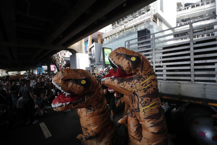 """Dinosaur mascots are seen at a student rally in Bangkok, Saturday, Nov. 21, 2020. Organized by a group that mockingly calls themselves """"Bad Students,"""" the rally calls for educational reforms and also supports the broader pro-democracy movement's demands for constitutional change. (AP Photo/Sakchai Lalit)"""