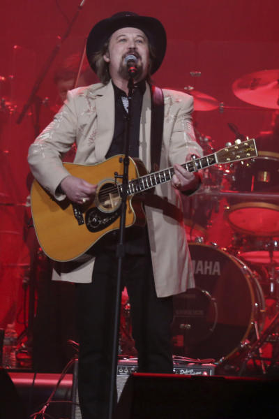 """FILE - In this Feb. 8, 2017 file photo, Travis Tritt performs at """"1 Night. 1 Place. 1 Time.: A Heroes and Friends Tribute to Randy Travis"""" at Bridgestone Arena in Nashville, Tenn.Country music star Tritt says his tour bus was """"sideswiped"""" in a multi-vehicle crash that left several people dead in South Carolina. News outlets report the crash occurred early Saturday, May 18, 2019, on Highway 22 in Horry County. (Photo by Laura Roberts/Invision/AP, File)"""