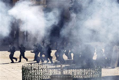 Israeli policemen react in clashes with Palestinians on the compound known to Muslims as the Noble Sanctuary and to Jews as the Temple Mount in Jerusalem's Old City