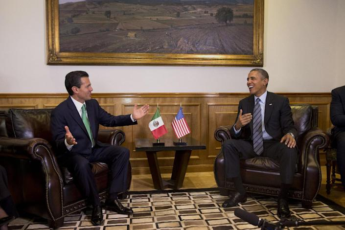 """President Barack Obama meets with Mexican President Enrique Peña Nieto at the state government palace in Toluca, Mexico on Wednesday, Feb. 19, 2014, before the seventh trilateral North American Leaders Summit Meeting. This year's theme is """"North American Competitiveness."""" (AP Photo/Jacquelyn Martin)"""