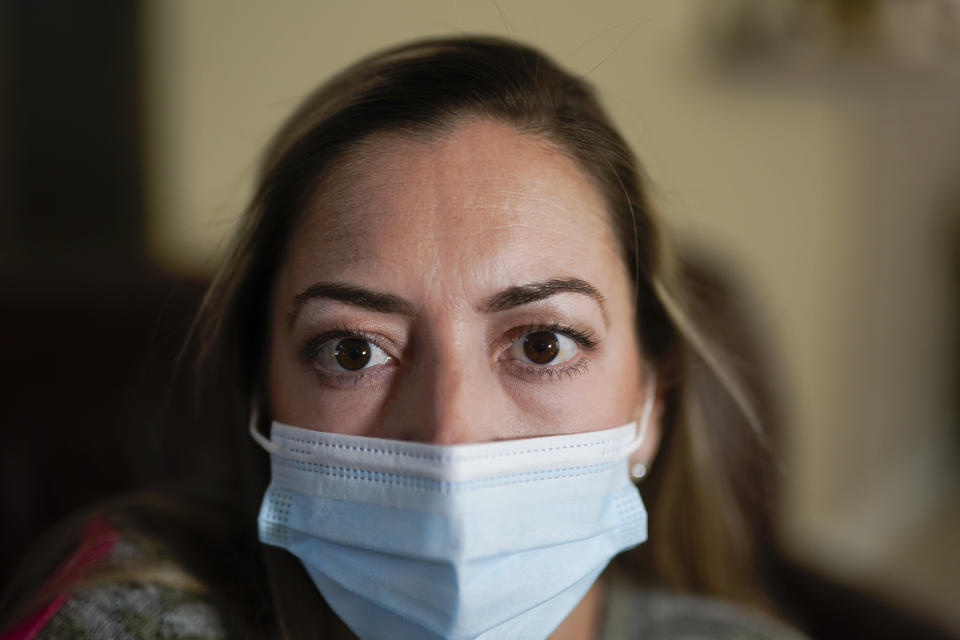 Maura Wozniak poses for a picture on Tuesday, Feb. 23, 2021, in Huntersville, N.C. Wozniak, a 42-year-old mother of 2 has cystic fibrosis and also has undergone lung transplants and has been moved into group 4, just ahead of the general public receive the COVID-19 vaccination. (AP Photo/Chris Carlson)