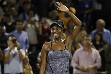 Mar 29, 2017; Miami, FL, USA; Venus Williams of the United States waves to the crowd after her match against Angelique Kerber of Germany (not pictured) on day nine of the 2017 Miami Open at Crandon Park Tennis Center. Williams won 7-5, 6-3. Geoff Burke-USA TODAY Sports