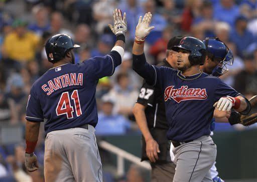 Cleveland Indians' Mike Aviles, right, celebrates with teammate Carlos Santana after hitting a three-run home run in the third inning of their second baseball game against the Kansas City Royals, Sunday, April 28, 2013, in Kansas City, Mo. (AP Photo/Reed Hoffmann)