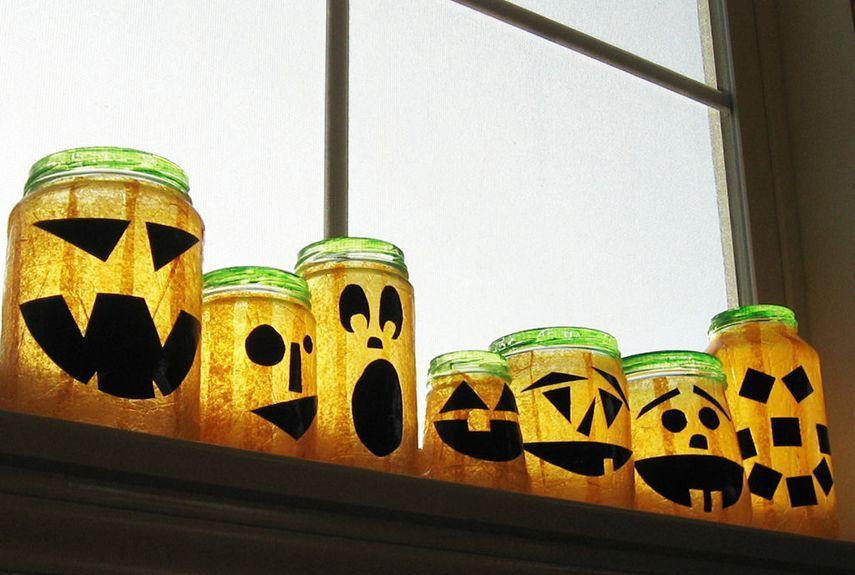 """<p>Got some old spaghetti sauce jars lying around? Then you're halfway to creating this adorable vignette.</p><p><strong>Get the tutorial at <a href=""""http://www.instructables.com/id/Recycled-Jar-Jack-OLanterns/"""" rel=""""nofollow noopener"""" target=""""_blank"""" data-ylk=""""slk:Not So Idle Hands"""" class=""""link rapid-noclick-resp"""">Not So Idle Hands</a>.</strong> </p>"""