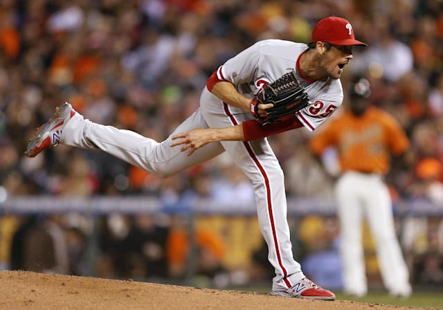 Philadelphia Phillies pitcher Cole Hamels watches a throw during the fourth inning of a baseball game against the San Francisco Giants, Friday, Aug. 15, 2014, in San Francisco. (AP Photo/Beck Diefenbach)