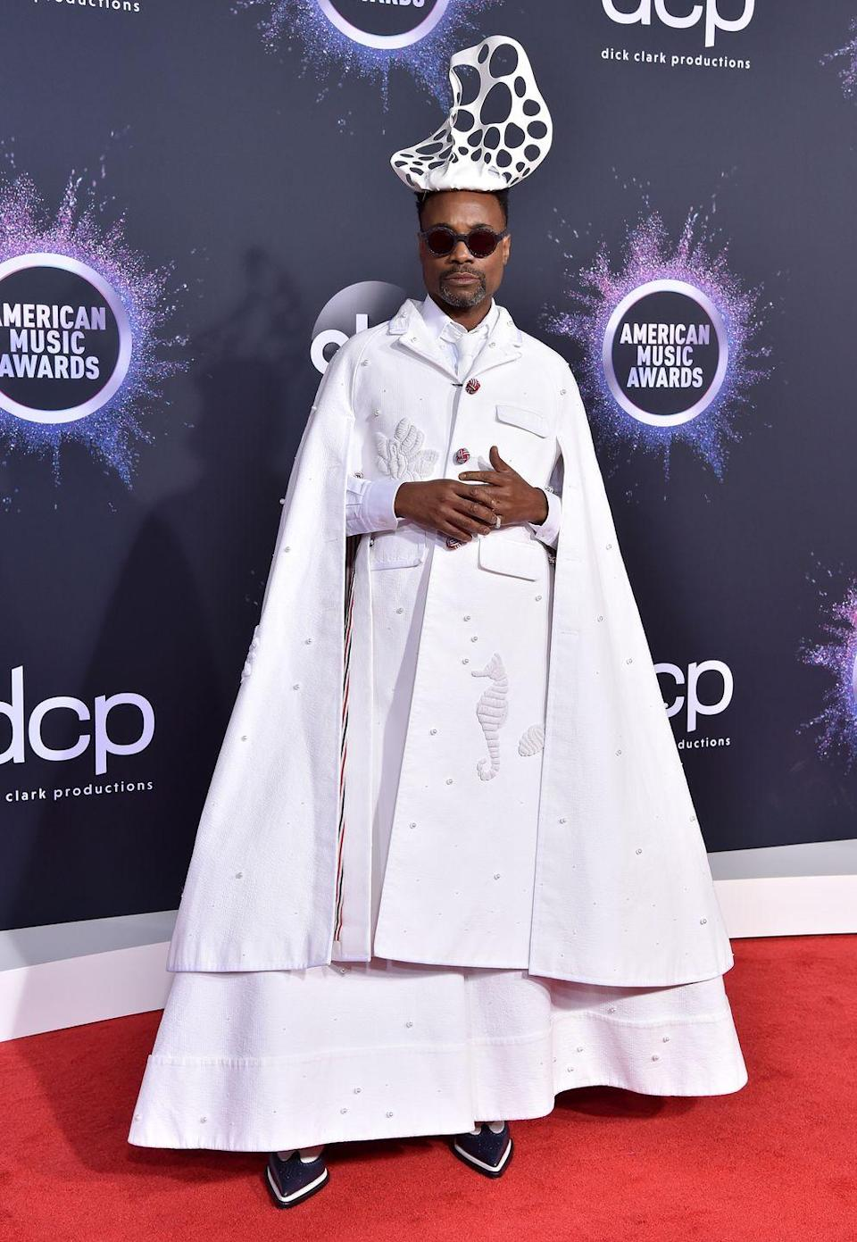 """<p>For the AMAs, Porter wore a Thom Browne SS20 menswear white coat, cape and gown, with a Stephen Jones Millinery headpiece and Oscar Heyman ring.</p><p>The star later <a href=""""https://twitter.com/theebillyporter/status/1198787046174646273?ref_src=twsrc%5Etfw%7Ctwcamp%5Etweetembed%7Ctwterm%5E1198787046174646273&ref_url=https%3A%2F%2Fabc7news.com%2F5716911"""" rel=""""nofollow noopener"""" target=""""_blank"""" data-ylk=""""slk:tweeted"""" class=""""link rapid-noclick-resp"""">tweeted</a> that the look had 'hints of red, white and blue because I'm an American' and introduced Camila Cabello on the night by saying: 'Understated. Low-key. Restrained.</p><p>'That is not how I approach the roles I play or the red carpet. Look at me, I'm an entire mood!'</p>"""