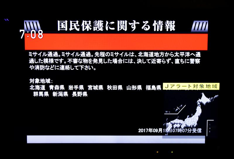 The Japanese government's alert message called J-alert notifying citizens of a ballistic missile launch by North Korea is seen on a television screen in Tokyo