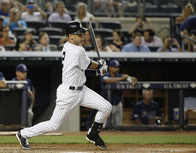 New York Yankees Derek Jeter hits a sixth-inning single off Tampa Bay Rays starting pitcher David Price in a baseball game at Yankee Stadium in New York, Tuesday, July 1, 2014. (AP Photo/Kathy Willens)
