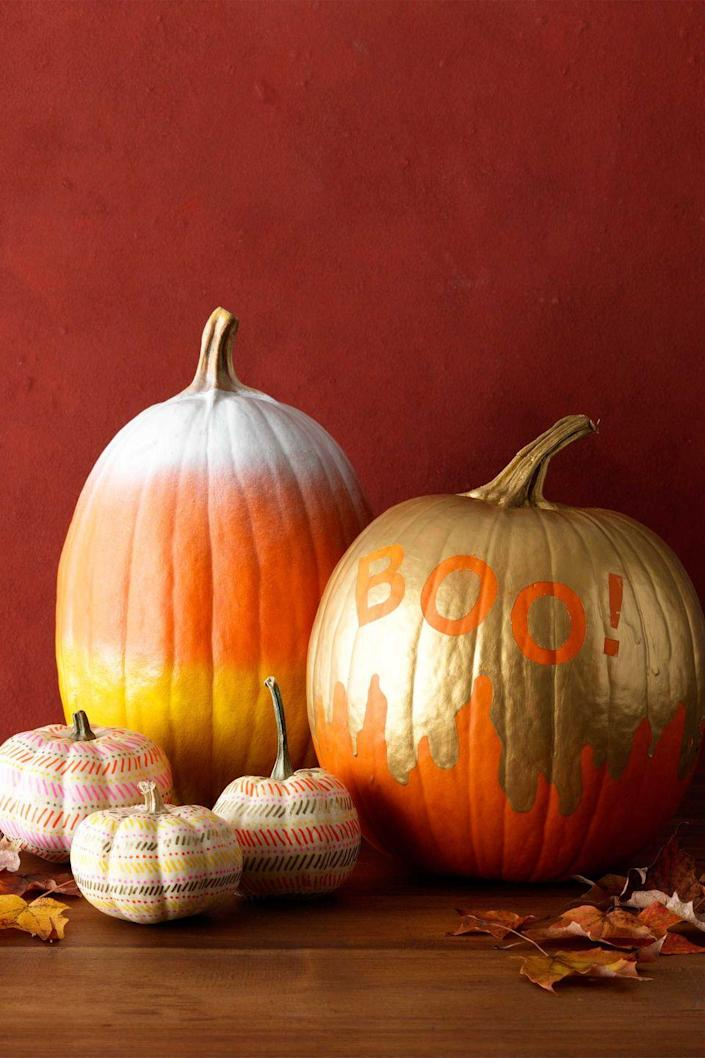 """<p>Give your pumpkin some fun flair with this favorite phrase. Apply letter stickers as shown, then use a paintbrush to make a drip design in gold paint around the pumpkin. Paint everything above this line gold. Once dry, peel away and discard the stickers.</p><p><a class=""""link rapid-noclick-resp"""" href=""""https://www.amazon.com/TecUnite-Alphabet-Stencils-Painting-Decoration/dp/B075QZJJ15/?tag=syn-yahoo-20&ascsubtag=%5Bartid%7C10070.g.1902%5Bsrc%7Cyahoo-us"""" rel=""""nofollow noopener"""" target=""""_blank"""" data-ylk=""""slk:SHOP LETTER STENCILS"""">SHOP LETTER STENCILS</a></p>"""