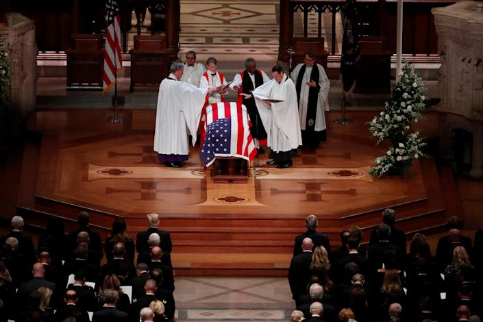 Members of the clergy bless the flag-draped casket of former President George H.W. Bush at the conclusion of his state funeral in the Washington National Cathedral in Washington, D.C., Dec. 5, 2018. (Photo: Kevin Lamarque/Reuters)