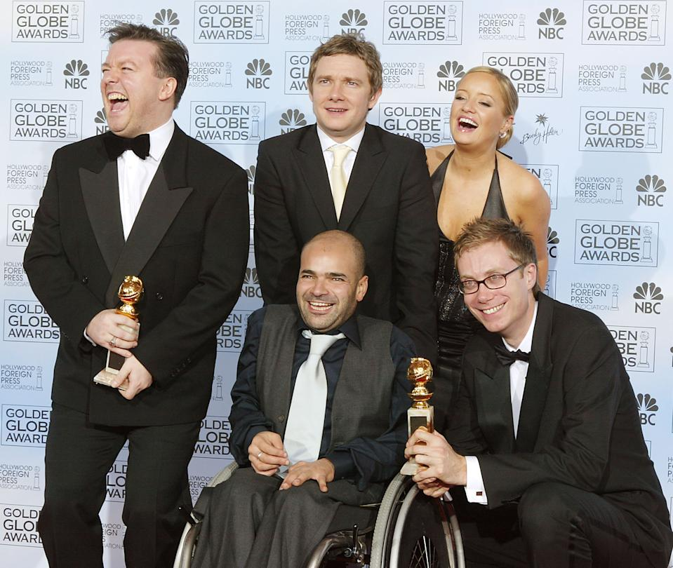 """BEVERLY HILLS, CA - JANUARY 25:   (L-R) Winners of Best Television Series """"The Office"""" Actors Ricky Gervais, Stephen Merchant, Ash Atalla, Lucy Davis, and Martin Freeman pose backstage at the 61st Annual Golden Globe Awards at the Beverly Hilton Hotel on January 25, 2004 in Beverly Hills, California. (Photo by Kevin Winter/Getty Images)"""