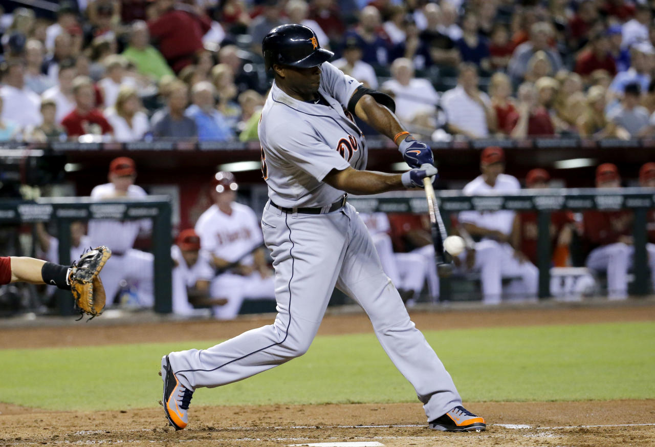 Detroit Tigers' Torii Hunter hits against the Arizona Diamondbacks during the third inning of a baseball game, Monday, July 21, 2014, in Phoenix. (AP Photo/Matt York)