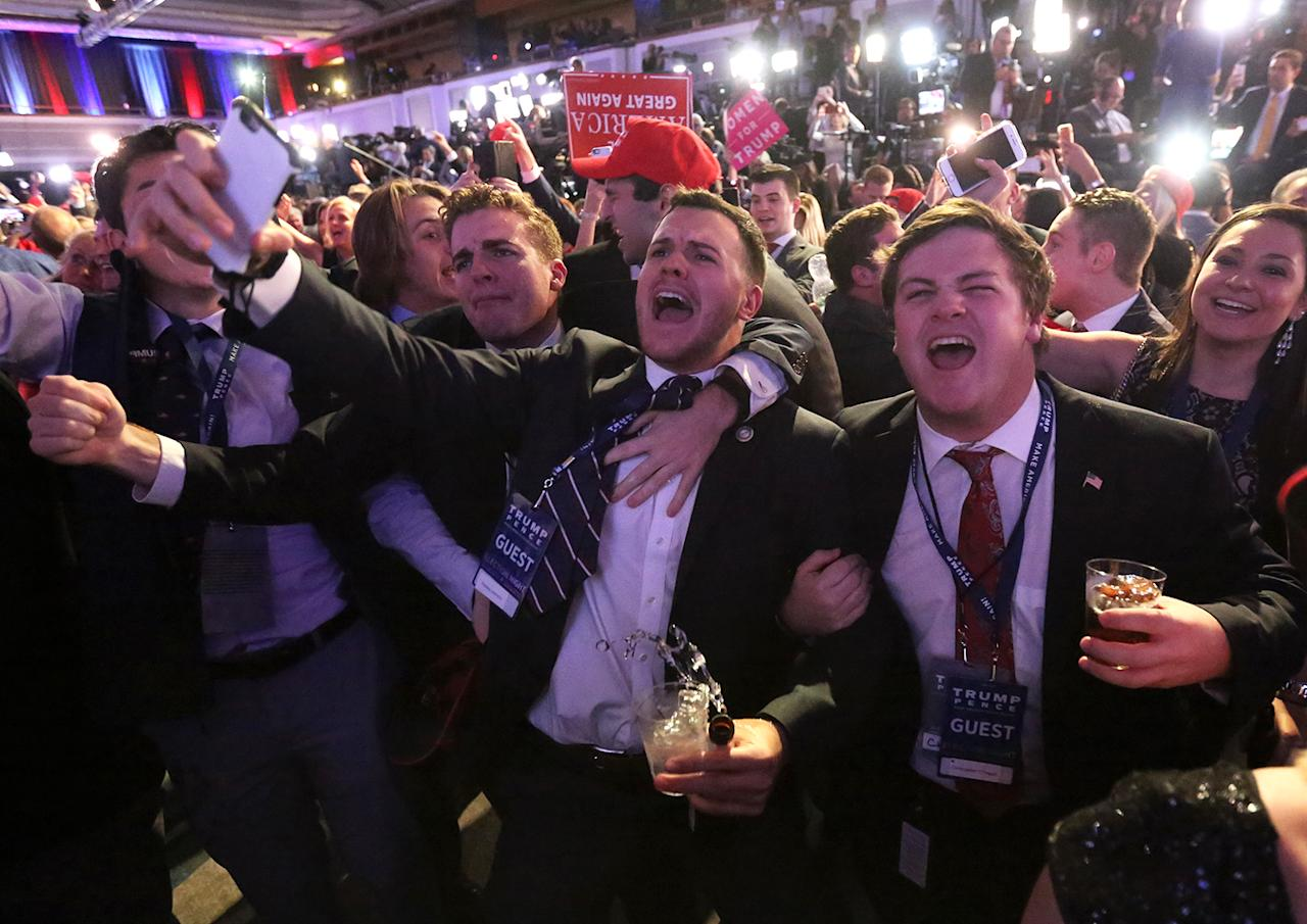 <p>Supporters of U.S. Republican presidential nominee Donald Trump react at his election night rally in Manhattan, New York, U.S., November 8, 2016. (REUTERS/Carlo Allegri) </p>