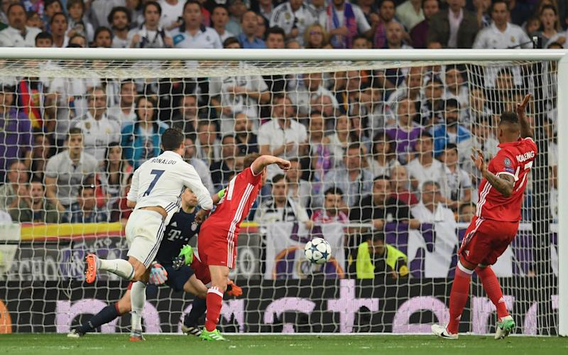 Cristiano Ronaldo of Real Madrid scores his sides first goal past Manuel Neuer  - Credit: GETTY