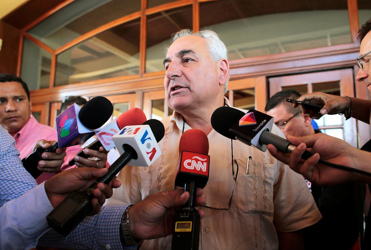 Special envoy of the OAS General Secretariat Luis Angel Rosadilla speaks with journalists after a meeting with Cristobal Fernandez, chief of the Department of Cooperation and Electoral Observation of OAS in Managua, Nicaragua April 24, 2019.REUTERS/Oswaldo Rivas