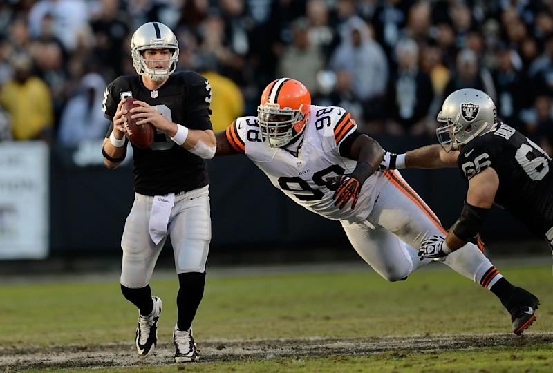 OAKLAND, CA - DECEMBER 02:  Carson Palmer #3 of the Oakland Raiders scrambles away from the presure of Phil Taylor #98 of the Cleveland Browns during the third quarter at Oakland-Alameda County Coliseum on December 2, 2012 in Oakland, California.  (Photo by Thearon W. Henderson/Getty Images)