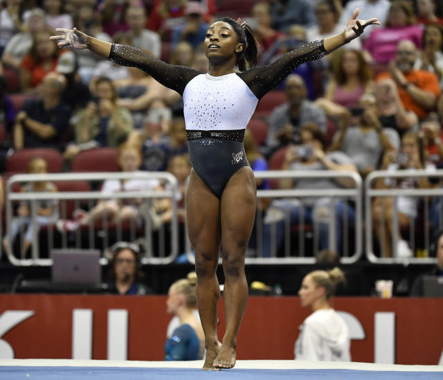 Simone Biles begins her floor exercise routine during the GK US Classic gymnastics meet in Louisville, Ky., Saturday, July 20, 2019. (AP Photo/Timothy D. Easley)
