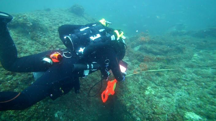 Michael Barnette measuring the wreck of the SS Cotopaxi. (Photo: Science Channel)