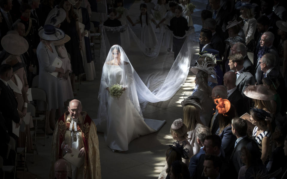 Meghan Markle walks down the aisle as she arrives in St George's Chapel at Windsor Castle for her wedding to Prince Harry.