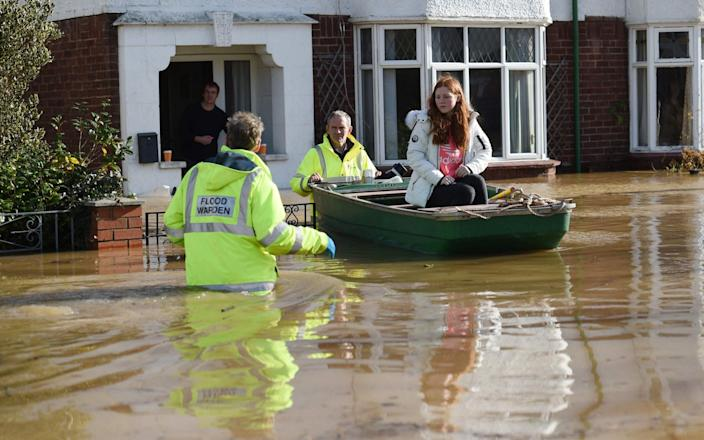 Residents are rescued from their homes in Hereford - AFP/Oli Scarff