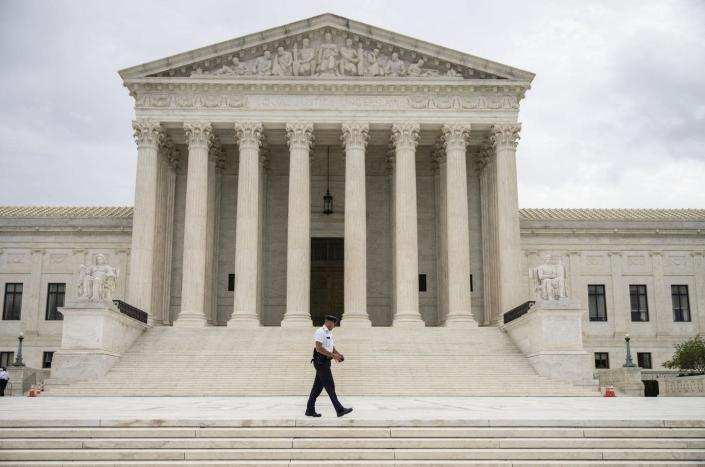 """<span class=""""caption"""">The U.S. Supreme Court has allowed Texas' abortion restrictions to take effect.</span> <span class=""""attribution""""><a class=""""link rapid-noclick-resp"""" href=""""https://www.gettyimages.com/detail/news-photo/supreme-court-police-officer-patrols-at-the-u-s-supreme-news-photo/1234993989?adppopup=true"""" rel=""""nofollow noopener"""" target=""""_blank"""" data-ylk=""""slk:Drew Angerer/Getty Images"""">Drew Angerer/Getty Images</a></span>"""