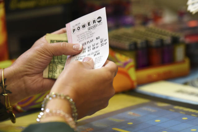 <p>Customer buys a Powerball ticket, Aug. 22, 2017, in Chicago, officials estimated jackpot for Wednesday night's Powerball lottery game has climbed to $700 million, making it the second largest in U.S. history. (Photo: G-Jun Yam/AP) </p>