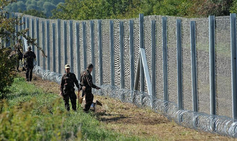 Hungary says it has stopped the influx of migrants and refugees after erecting a fence on its border with Croatia (AFP Photo/Elvis Barukcic)