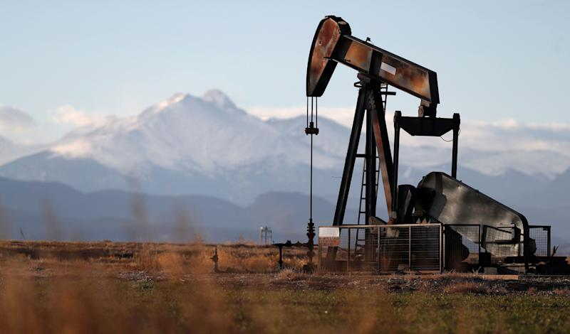 In this Saturday, Dec. 22, 2018, file photograph, a pump jack is shown over an oil well along Interstate 25 near Dacono, Colo. traffic flows on Interstate 25 into downtown Denver. (Photo: David Zalubowski/AP)