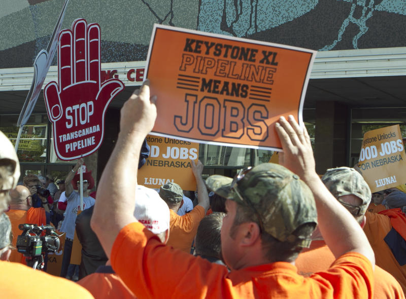FILE - In this Sept. 11, 2011, file photo demonstrators for and against the Keystone XL pipeline gather near the state Capitol in Lincoln, Neb., as public hearings take place about the proposed Keystone XL Pipeline, which would carry tar sands oil from Canada to Texas through the sandhills of Nebraska. Supporters of the pipeline, which include labor unions and business groups, spoke of jobs and development and energy security. AFL-CIO leaders hope to smooth tensions at their executive council's annual winter meeting that starts Monday, March 12, 2012, in Orlando, Fla., with union leaders trying to repair bitter divisions over Obama's rejection of the pipelines. (AP Photo/Nati Harnik, File)