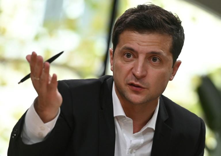 Ukrainian President Volodymyr Zelensky speaks to media on October 10, 2019