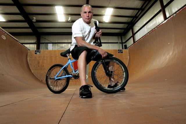 <p>Dave Mirra, a prominent figure in the world of BMX biking (he earned 24 medals at the X-Games), committed suicide on February 4 at age 41. Mirra was later diagnosed with chronic traumatic encephalopathy, most often associated with football players, and believed to be caused by repeated hits to the head. —(Pictured) X-Games athlete Dave Mirra poses in the half-pipe at his training facility in Greenville, N.C. in 2005. (AP Photo/Gerry Broome, File) </p>